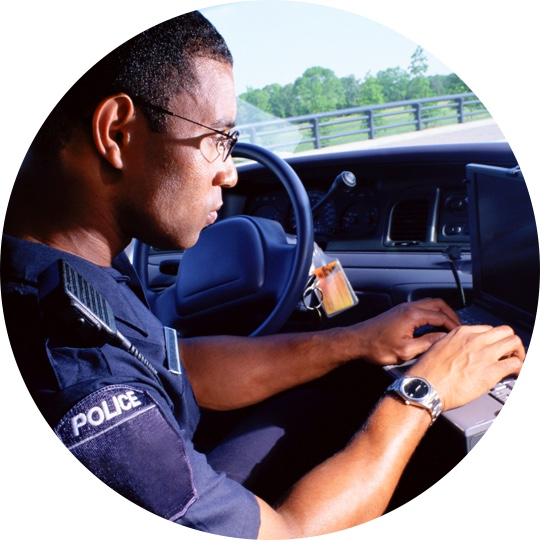 Police officer working to protect citizens and infrastructure in a smart community