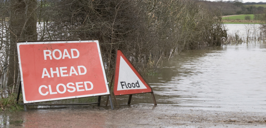 Worcestershire County Council Case Study Image - Road Ahead Closed Sign and Flooded Road